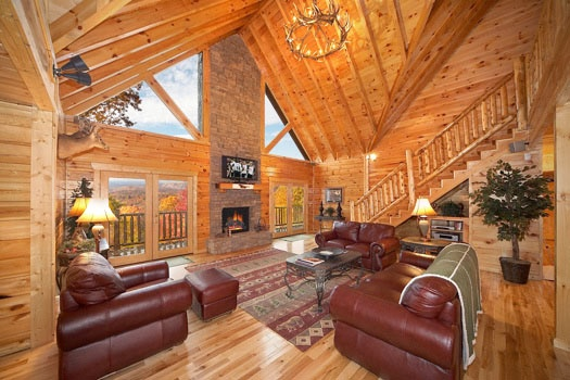 tall stone fireplace centered in the living room of big sky lodge a 3 bedroom cabin rental located in gatlinburg