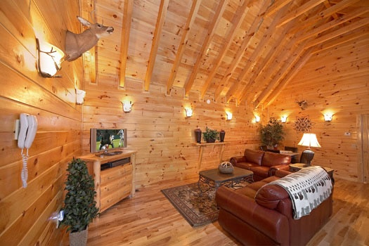 sofa bed and television in the loft at big sky lodge a 3 bedroom cabin rental located in gatlinburg