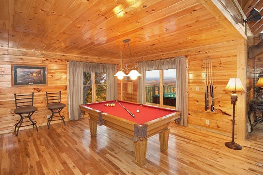 Red felted pool table off kitchen at Big Sky Lodge, a 3-bedroom rental located in Gatlinburg