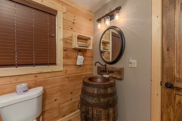 Custom barrel sink at Sawmill Springs, a 3 bedroom cabin rental located in Pigeon Forge