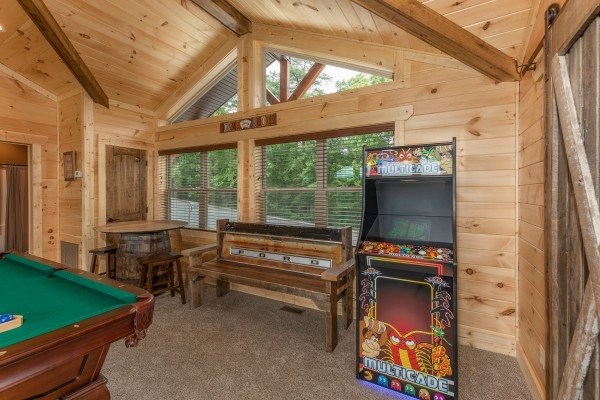 Arcade game in the game room at Sawmill Springs, a 3 bedroom rental cabin in Pigeon Forge