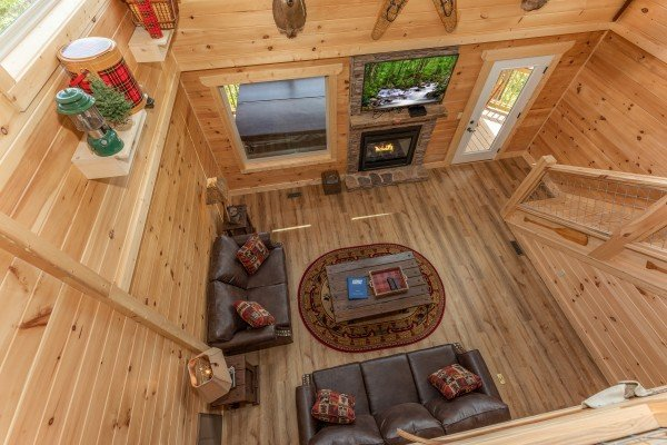 Looking down on the living room at Sawmill Springs, a 3 bedroom rental cabin in Pigeon Forge