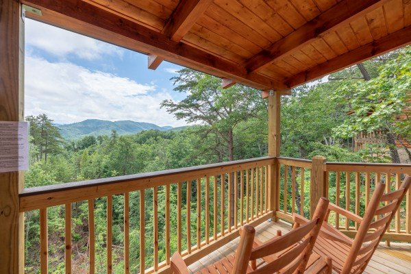 Rocking chairs and a mountain view at Sawmill Springs, a 3 bedroom rental cabin in Pigeon Forge