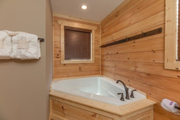 Corner jacuzzi tub at Sawmill Springs, a 3 bedroom cabin rental located in Pigeon Forge