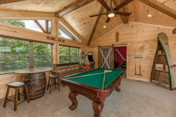 Game room with pool table and arcade game at Sawmill Springs, a 3 bedroom rental cabin in Pigeon Forge
