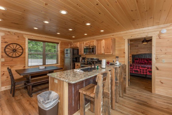 Breakfast bar and kitchen at Sawmill Springs, a 3 bedroom cabin rental located in Pigeon Forge