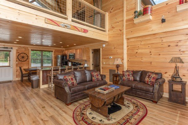 Seating in the living room at Sawmill Springs, a 3 bedroom cabin rental located in Pigeon Forge