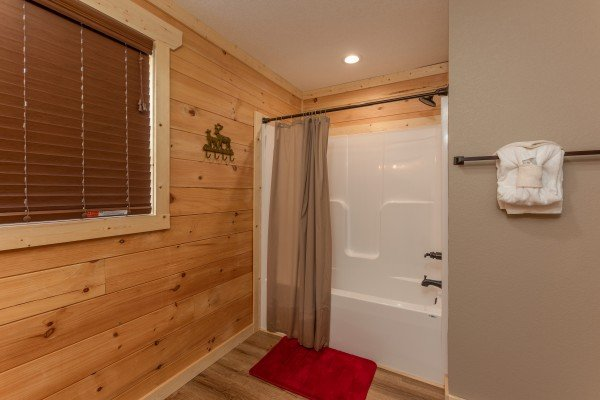 Bathroom with a tub and shower at Sawmill Springs, a 3 bedroom cabin rental located in Pigeon Forge