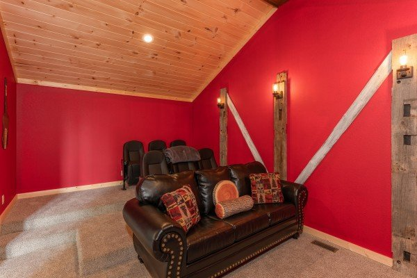 Sofa and movie seats in the home theater at Sawmill Springs, a 3 bedroom rental cabin in Pigeon Forge