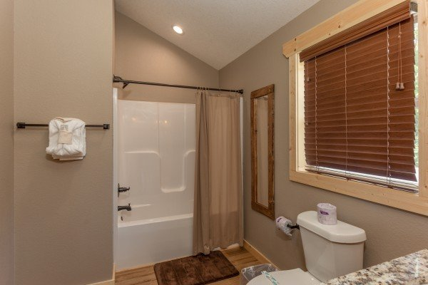 Bathroom with tub and shower at Sawmill Springs, a 3 bedroom rental cabin in Pigeon Forge