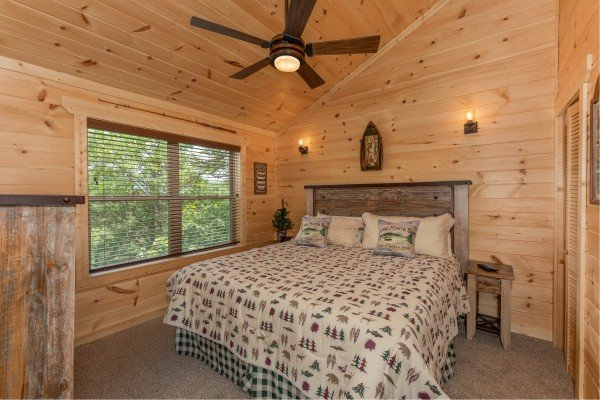 Bedroom with a king bed at Sawmill Springs, a 3 bedroom rental cabin in Pigeon Forge