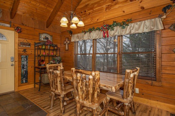 Dining space for six at Pigeon Forge Pleasures, a 3 bedroom cabin rental located in Pigeon Forge