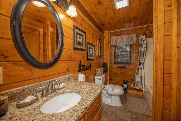 Bathroom with a tub and shower at Pigeon Forge Pleasures, a 3 bedroom cabin rental located in Pigeon Forge