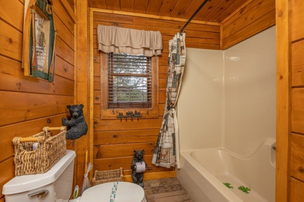 Tub and shower at Pigeon Forge Pleasures, a 3 bedroom cabin rental located in Pigeon Forge