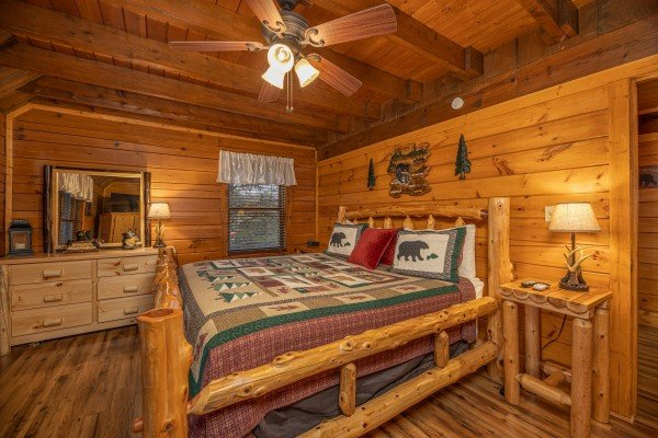 Bedroom with a log bed, night stand, and dresser at Pigeon Forge Pleasures, a 3 bedroom cabin rental located in Pigeon Forge