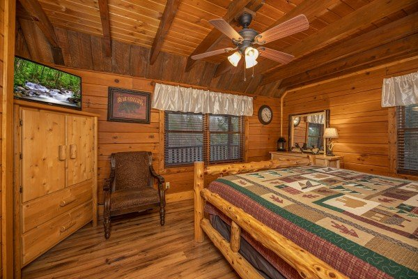 Armoire, TV, and chair in a bedroom at Pigeon Forge Pleasures, a 3 bedroom cabin rental located in Pigeon Forge