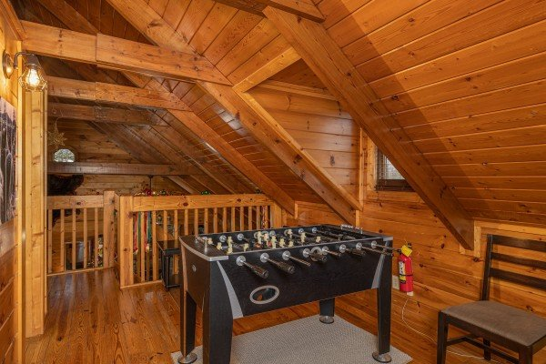 Foosball table at Pigeon Forge Pleasures, a 3 bedroom cabin rental located in Pigeon Forge