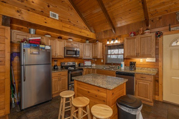 Kitchen with stainless appliances and island at Pigeon Forge Pleasures, a 3 bedroom cabin rental located in Pigeon Forge