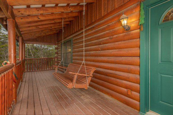 Porch swing at Pigeon Forge Pleasures, a 3 bedroom cabin rental located in Pigeon Forge