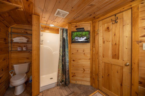 Bathroom with shower and TV at Pigeon Forge Pleasures, a 3 bedroom cabin rental located in Pigeon Forge