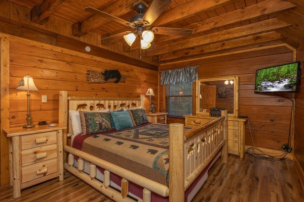 Dresser, night stand, and TV in a bedroom at Pigeon Forge Pleasures, a 3 bedroom cabin rental located in Pigeon Forge