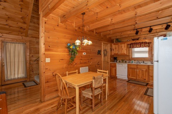 Dining space and kitchen at Bearly Mine, a 1 bedroom Pigeon Forge cabin rental