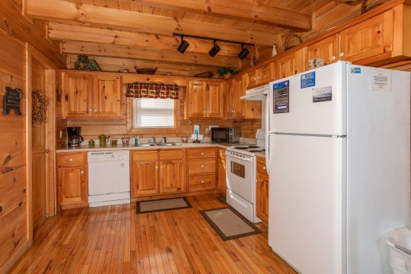 Kitchen with white appliances at Bearly Mine, a 1 bedroom Pigeon Forge cabin rental