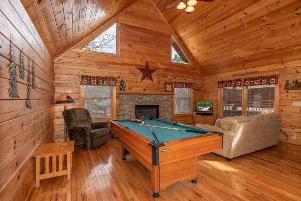Pool table in the living room at Bearly Mine, a 1 bedroom Pigeon Forge cabin rental