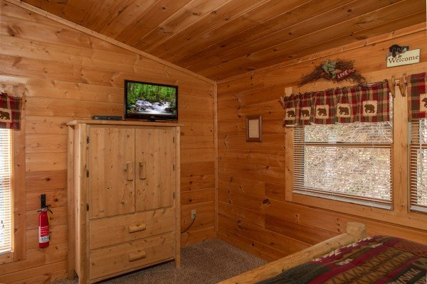 Armoire and TV in the bedroom at Bearly Mine, a 1 bedroom Pigeon Forge cabin rental