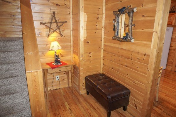 Bench in the foyer at Bearly Mine, a 1-bedroom cabin rental located in Pigeon Forge