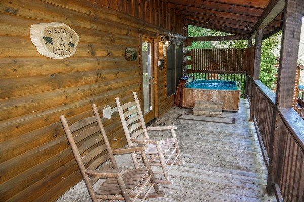 Rocking chairs on the deck at Bearly Mine, a 1-bedroom cabin rental in Pigeon Forge