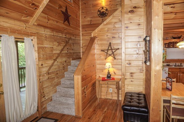 Staircase up to second floor at Bearly Mine, a 1-bedroom cabin rental located in Pigeon Forge