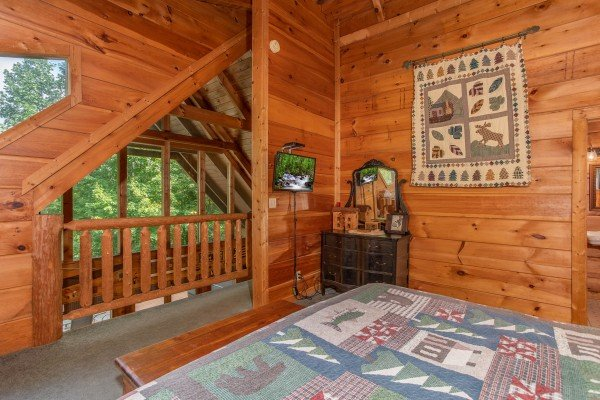Bedroom with loft views at Aw Paw's Place, a 1-bedroom cabin rental located in Pigeon Forge
