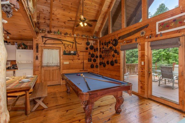 Pool table in the living room at Aw Paw's Place, a 1-bedroom cabin rental located in Pigeon Forge