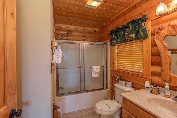 Bathroom with a tub and shower at I Do Love Views, a 3 bedroom cabin rental located in Pigeon Forge