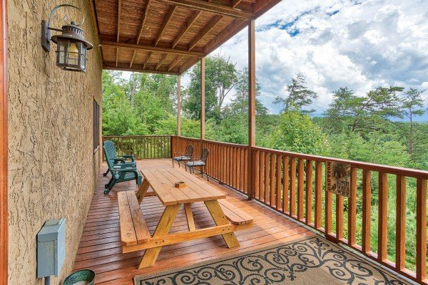 Picnic able on the deck at I Do Love Views, a 3 bedroom cabin rental located in Pigeon Forge