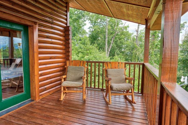Rocking chairs on the covered deck at I Do Love Views, a 3 bedroom cabin rental located in Pigeon Forge