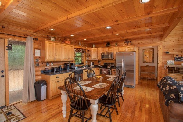 Dining space for six in the kitchen with stainless appliances at I Do Love Views, a 3 bedroom cabin rental located in Pigeon Forge