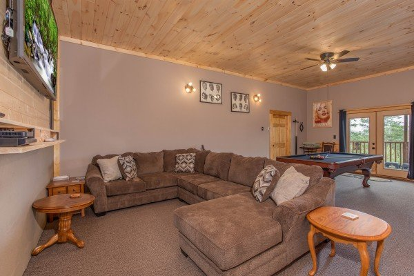 Game room with large sectional sofa and pool table at I Do Love Views, a 3 bedroom cabin rental located in Pigeon Forge