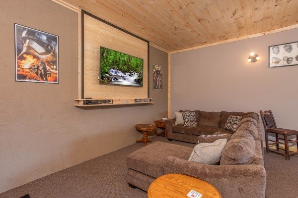 Television and large sectional sofa in the game room at I Do Love Views, a 3 bedroom cabin rental located in Pigeon Forge