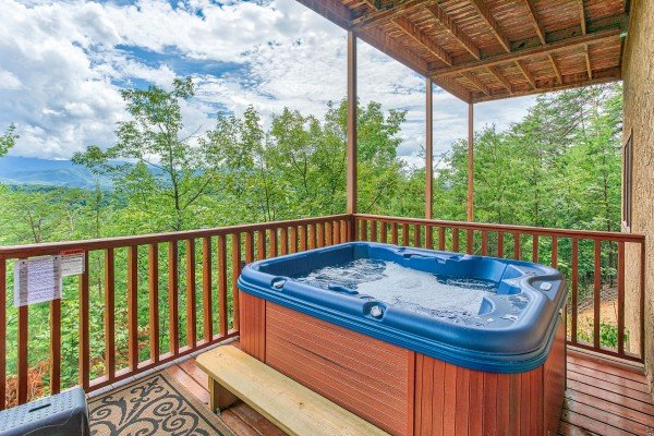 Hot tub on a covered deck at I Do Love Views, a 3 bedroom cabin rental located in Pigeon Forge