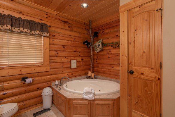 Jacuzzi in the corner of a bathroom at I Do Love Views, a 3 bedroom cabin rental located in Pigeon Forge