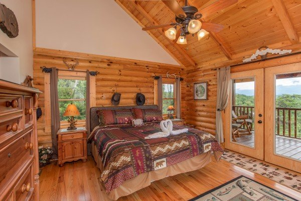 King bedroom with deck access on the upper floor at I Do Love Views, a 3 bedroom cabin rental located in Pigeon Forge