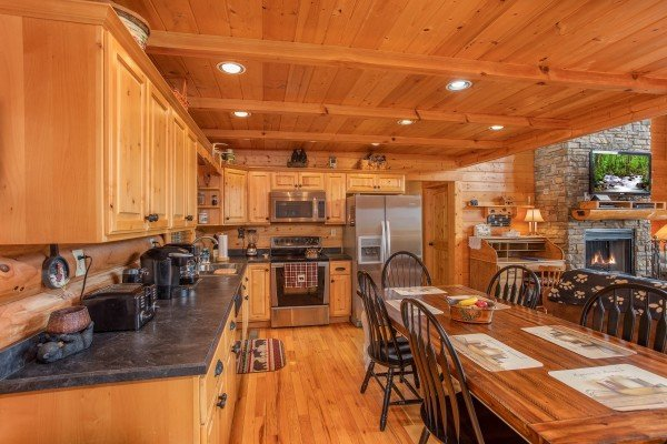 Kitchen with stainless steel appliances and dining space for six at I Do Love Views, a 3 bedroom cabin rental located in Pigeon Forge