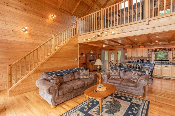 Living room with sofa and loveseat at I Do Love Views, a 3 bedroom cabin rental located in Pigeon Forge