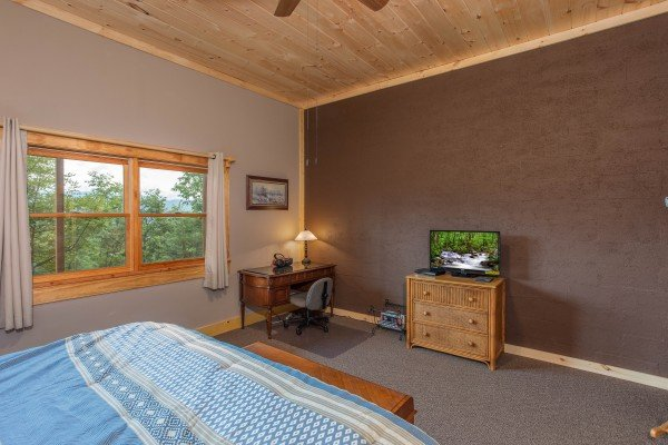 Writing desk and a television on a small chest of drawers at I Do Love Views, a 3 bedroom cabin rental located in Pigeon Forge