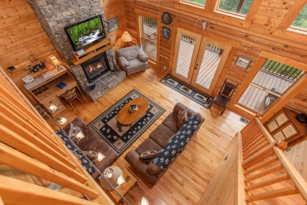 Looking down into the living room from the upper floor at I Do Love Views, a 3 bedroom cabin rental located in Pigeon Forge