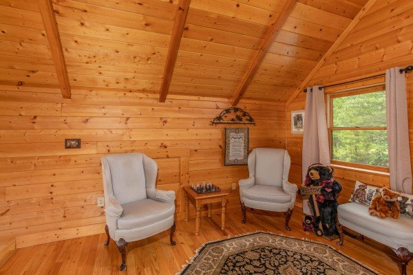 Sitting area with two plush chairs in the loft space at I Do Love Views, a 3 bedroom cabin rental located in Pigeon Forge