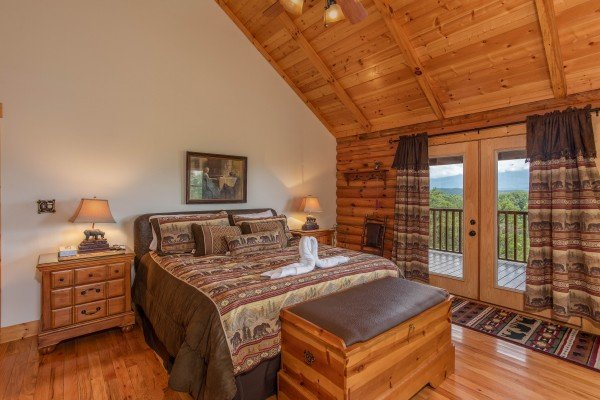 Bedroom with deck access at I Do Love Views, a 3 bedroom cabin rental located in Pigeon Forge