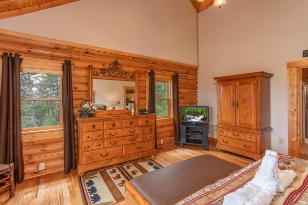 Bedroom with a dresser and mirror, armoire, and television at I Do Love Views, a 3 bedroom cabin rental located in Pigeon Forge